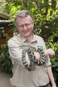 man-holding-snake;vet-holding-snake-in-care;carrumbin-wildlife-sanctuary