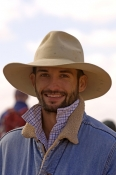 young-australian-man;young-aussie;man-with-hat-on;iconic-australian-man;outback-man;station-man;marree-camel-races