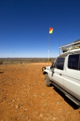 chambers-pillar;chambers-pillar-historical-reserve;4wd-chambers-pillar;4wd-simpson-desert;4wd;4WD;four-wheel-drive;central-australia;northern-territory;steven-david-miller;natural-wanders;4wd-with-warning-flag;4wd-warning-flag