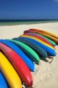 moreton-island;moreton-island-national-park;sand-island;colourful-colorful-kayaks;kayaks-on-beach;beach-with-boats;queensland-island;tangalooma-resort