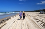 flinders-beach;stradbroke-island;north-stradbroke-island;straddie;people-walking-on-beach;couple-walking-on-beach;sand-island;beach;queensland-island;r