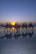 cable-beach;broome;cable-beach-camel-ride;broome-camel-ride;broome-attractions;western-australia;camels-on-the-beach;camels-on-cable-beach;camel-parade;people-riding-camels