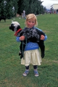 little-girl-holding-pet;little-girl-holding-lamb;school-fete;new-zealand-girl;girl-in-new-zealand