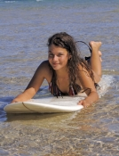 woman-on-surfboard;woman-surfer;woman-lying-on-surfboard;woman-paddling-surfboard;byron-bay-surfer