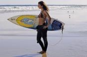 woman-on-surfboard;woman-surfer;woman-lying-on-surfboard;woman-paddling-surfboard;byron-bay-surfer